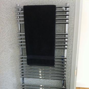 Heated towel rail with towel