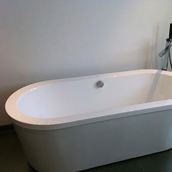 Rounded grey bath tub